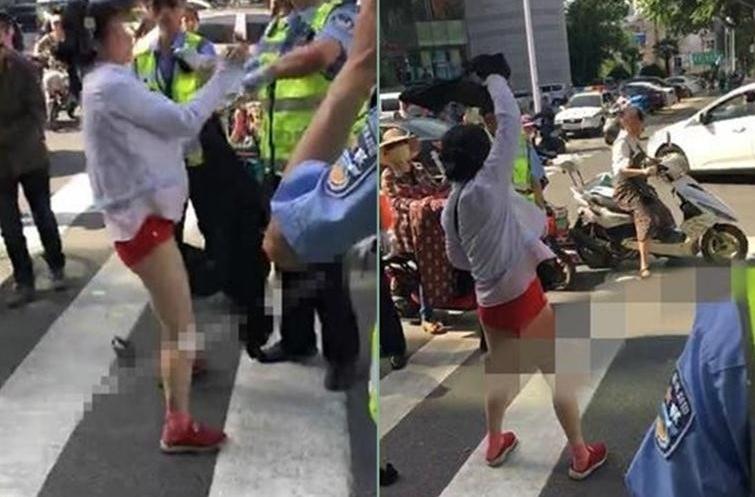 女子交警面前脱衣 当众脱光衣服画面十分不雅